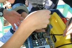 15_154attaching-transmitter-to-solar-battery-laura-kleger-photo